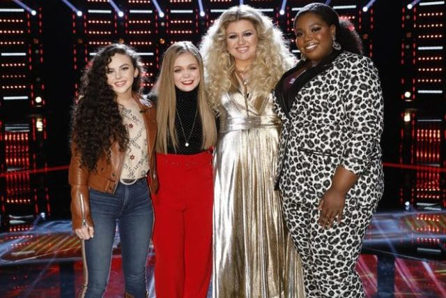 "THE VOICE -- ""Live Top 11 Results"" Episode 1516B -- Pictured: (l-r) Chevel Shepherd, Sarah Grace, Kelly Clarkson, Kymberli Joye -- (Photo by: Trae Patton/NBC)"