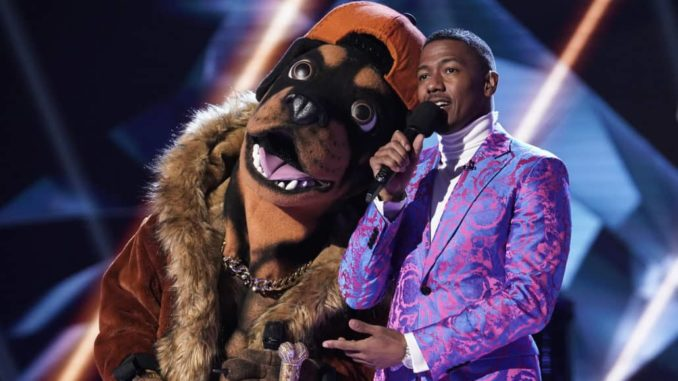 THE MASKED SINGER: L-R: The Rottweiler and host Nick Cannon in the all-new ?Mask Us Anything? episode of THE MASKED SINGER airing Wednesday, Nov. 6 (8:00-9:00 PM ET/PT) on FOX. © 2019 FOX MEDIA LLC. CR: Jack Zeman / FOX.